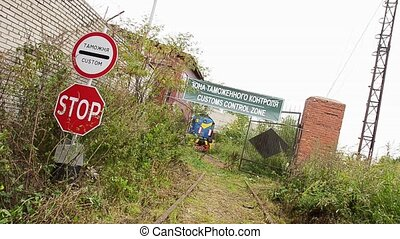 Abandoned depot with carriage and customs control signboard...