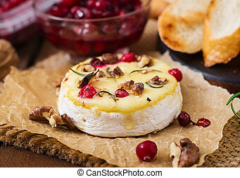 Baked cheese Camembert with cranberries and nuts
