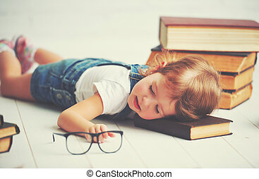 tired little girl fell asleep for books - tired child little...