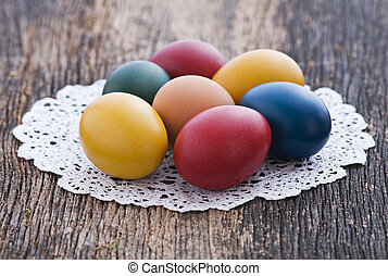 Easter eggs - Colorful easter eggs on wooden background...
