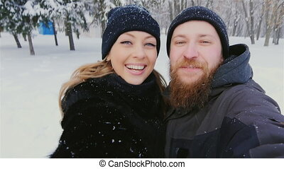 The bearded man and the woman photographed themselves on the...