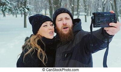 Attractive couple doing selfie in winter