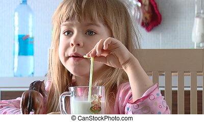 girl drinks milk.