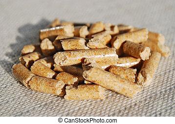 woodpellets - macro of woodpellets lying on the table