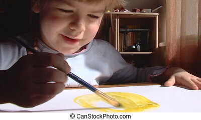 Little girl paint a water color