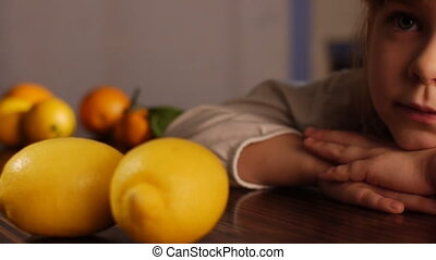 little girl and lemons - Dolly shot of the little girl and...