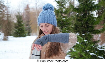 beautiful girl drinking from a thermos winter Full HD