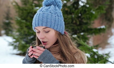 beautiful girl drinking from a thermos winter HD