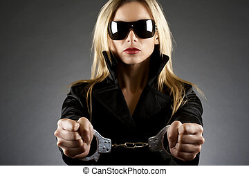 woman wearing handcuffs - Portrait of beautiful young sexy...