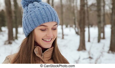 Girl uses protein in the park in winter and smiling HD