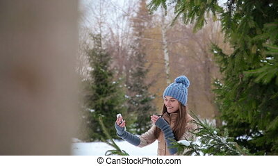 The girl photographed themselves - The girl drinks from a...