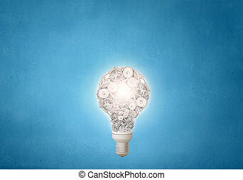 Gears light bulb - Conceptual image with light bulb and...