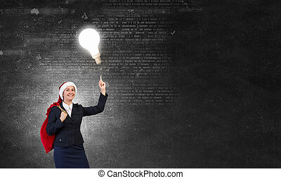 Santa woman with sack - Young businesswoman carrying big...