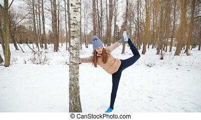 girl doing left leg split stretching exercises