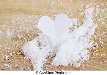 sea salt - white heart paper on sea salt, use for background