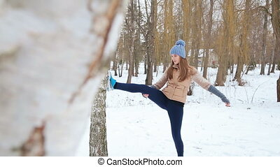 Winter training Fitness model athlete girl warm up...