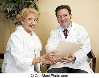 Happy Doctor With Patient - Friendly doctor going over a...