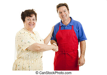 Woman and Worker - Mature lady shopping, shaking hands with...