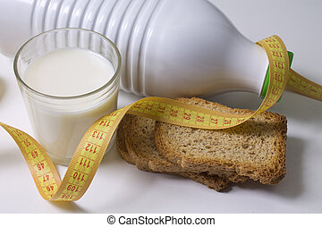 glass of milk with tape measure isolated