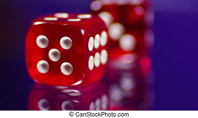 Playing red Casino Dice Cubes on a Glass Table - Red dice...
