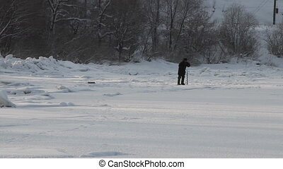 On winter fishing - The fisherman on winter fishing in...