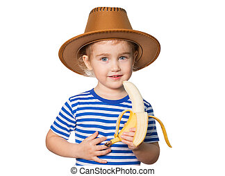Little Funny girl eats banana - Little Funny girl in striped...