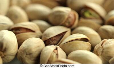 Pistachio nuts background. a pile of pistachios rotating...