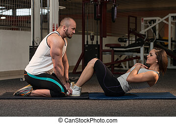 Couple Doing Sit-Ups Abdominal Crunch - Young Couple Doing...