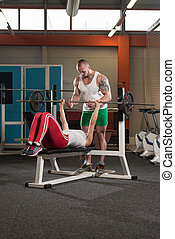 Woman Exercising With Her Personal Trainer - Personal...