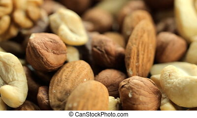 Nuts background with a mixed assortment of seeds with...