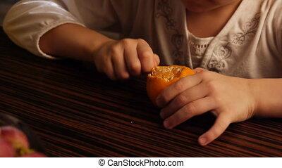 Little girl and mandarine