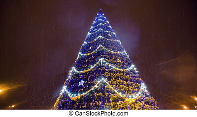 Bright Christmass tree with garland at city - Christmass...