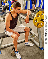 Man working with dumbbells at gym - Strong man in black...