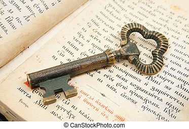 Closeup of key placed on vintage bible - Background of...