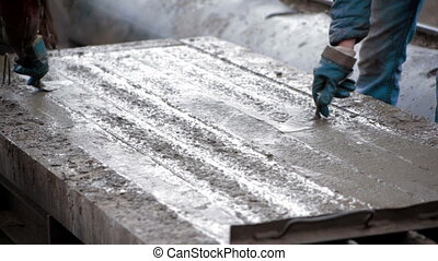 The creation of a reinforced concrete slab - Concrete is...