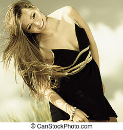 Happy smiling woman outdoor. Vacation day leisure concept....