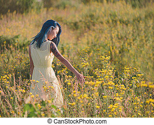 Girl walking on flower field