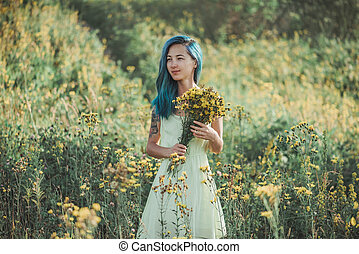 Attractive girl walking on flower field