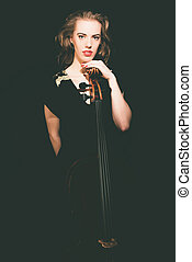 Pretty Female Musician Standing behind her Cello