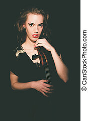 Seductive Young Woman Holding her Cello Instrument