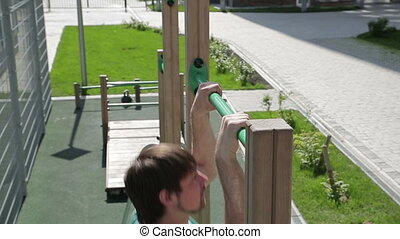 Pull-up on a horisontal bar - fitness, sport, exercising,...