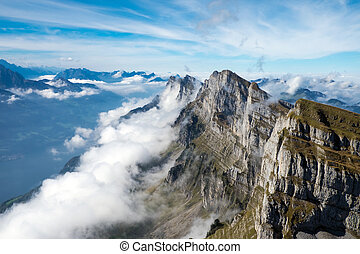 Clouds at the Churfirsten mountains in the swiss alps