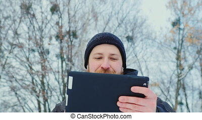 Attractive middle-aged man with a clipboard.