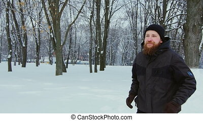 Attractive man on a morning jog in the winter