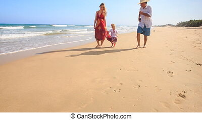 Little Girl Mother in Red Grandpa Run by Foamy Surf along...