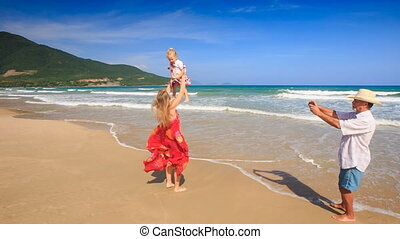 Blond Woman in Red Clasps Daughter to Breast Grandpa Photos...