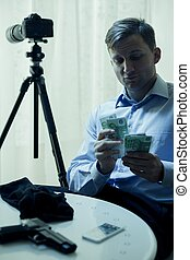 Contract killer counting his salary - Picture of contract...