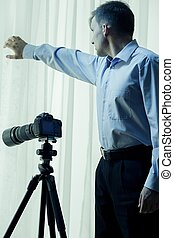 Private detective conducting investigation - Vertical view...