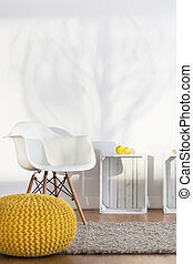 Interior in good style - Hand-knitted yellow pouffe, white...
