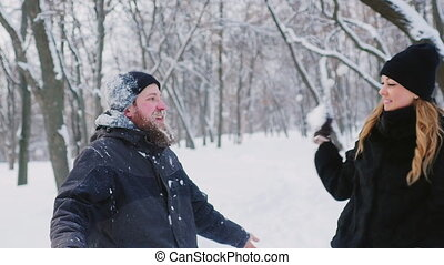 A couple having fun in the winter forest